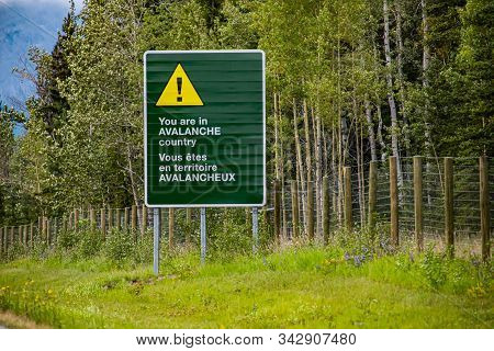 Two Languages French And English Information Road Bilingual Green Sign On Roadside, You Are In Avala