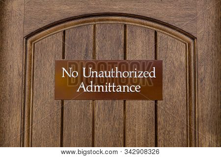 No Unauthorized Admittance, Brown Sign On A Wooden Door, Sign To Indicate That Entry Into The Area W
