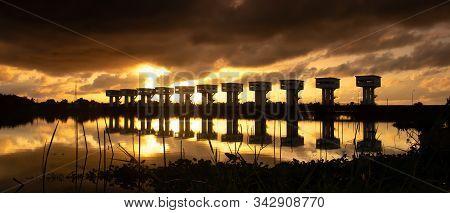 Sunrise And Canal With Uthokvibhajaprasidbarrage In Pak Phanang. Thailand