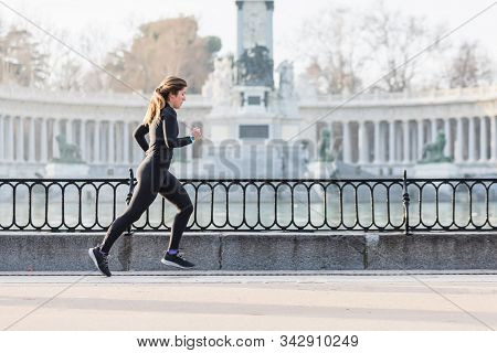 Woman Running In The Retiro Park In Madrid By A Lake. Sport
