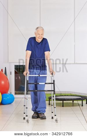 Old man with walker at physiotherapy in nursing home