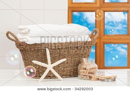 Basket of freshly laundered towels with pegs and bubbles