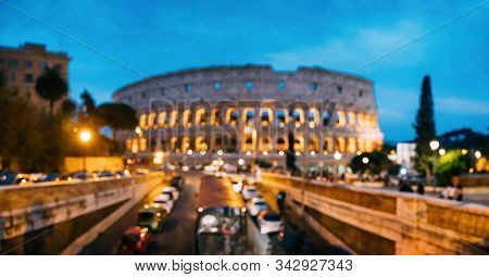 Rome, Italy. Colosseum Also Known As Flavian Amphitheatre. Traffic In Rome Near Famous World Landmar