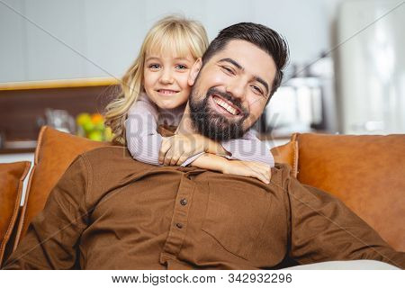 Adorable Little Girl Hugging Father From Behind