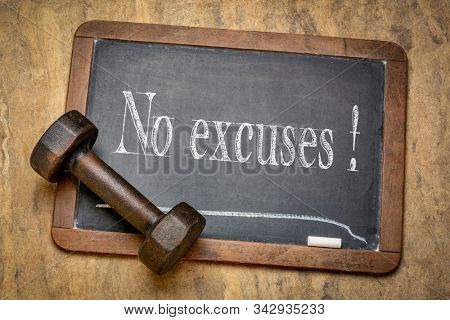 no excuses motivational reminder - white chalk text on a slate blackboard with a dumbbell, fitnes, persistence and determination concept