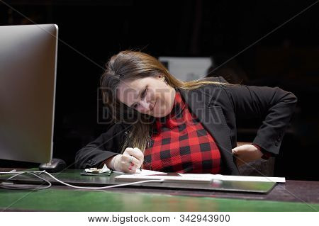 Office Manager Woman With Pain In Kidneys In The Workplace. Girl With Backache Clasping Her Hand To