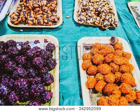 Marmalade Balls, Sprinkled With Dried Berries And Sweet Sawdust. Balls With Nuts And Marmalade. Tray