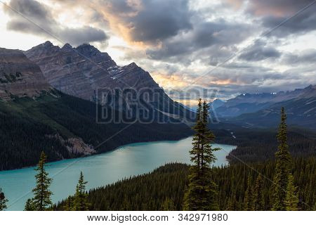 Canadian Rockies And Peyto Lake Viewed From The Top Of A Mountain During A Vibrant Summer Sunset. Ta