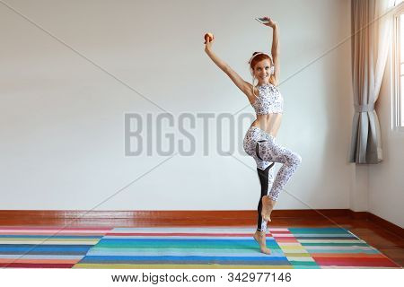 Young Attractive Caucasian Woman In Black And White Sportswear Who Listening And Dancing Music From