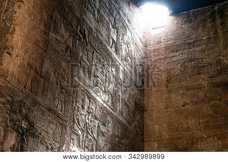 Enlightened Hieroglyphs Inside The Sanctuary At The Centre Of The Egyptian Temple Of Horus At Edfu,