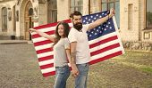American tradition. American patriotic people. American citizens couple USA flag outdoors. Patriotic spirit. Independence day. National holiday. Bearded hipster and girl celebrating. 4th of July. poster