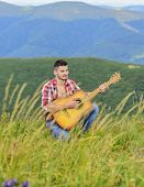 Acoustic music. Man with guitar on top of mountain. Summer music festival outdoors. Playing music. Sound of freedom. Inspired musician play rock ballad. Compose melody. Inspiring environment poster