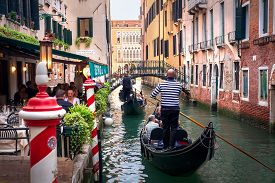 Venice, Italy - May 2, 2019: Italy, Walk In Traditional Gondola On Canal Of Venice. Venice Canal Bea
