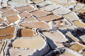Maras, Peru - October 11, 2015: Salt Evaporation Ponds At The Maras Salt Mines