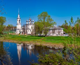 Old Church In Vologda, Russia, Europe. Blue Sunset Sky In Background And River In Foreground. Travel