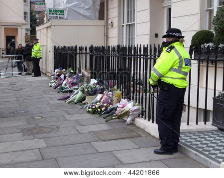 LONDON - UK, April 08: A policewoman and a policeman standing next to Margaret Thatcher's residence on Chester Square on April 8, 2013 in London.