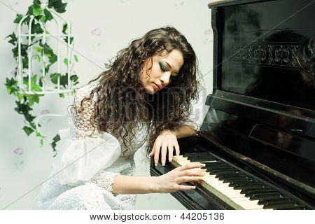 Romantic Girl Playing Piano