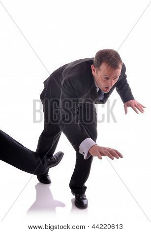 Image of a business man being tripped up poster