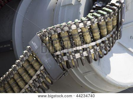 Round of ammunition loaded into .50-caliber machine gun on US Navy destroyer during Fleet Week 2012