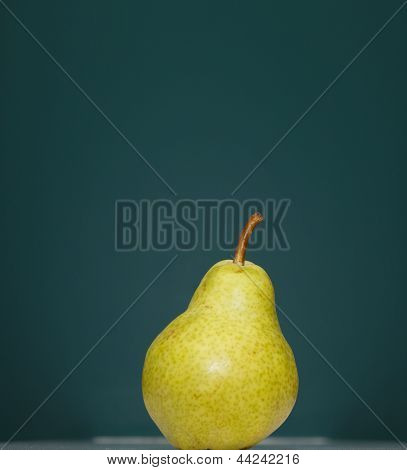 One Pear On Green Background