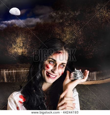Spooky Girl With Silver Service Bell In Graveyard
