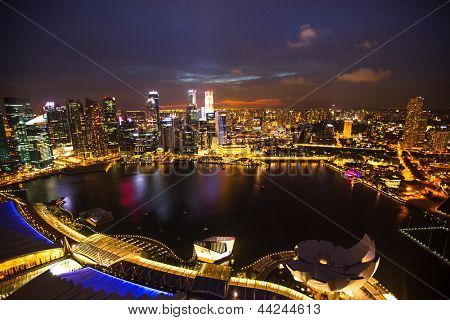 SINGAPORE - APRIL 15: A view of city from roof Marina Bay Hotel in night on April 15, 2012 on Singapore. This hotel is billed as the world's most expensive standalone casino property at S$8 billion.