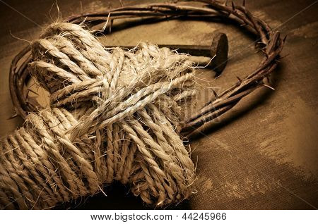 closeup of a representation of the Jesus Christ crown of thorns and nail, and a rope cross