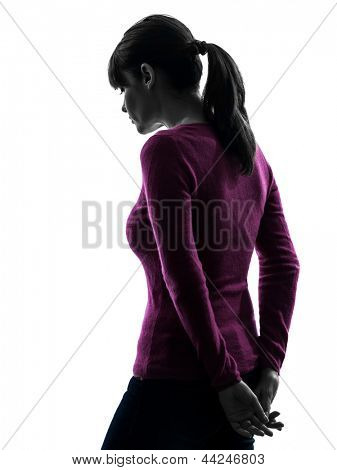 one caucasian woman sad moody rear view in silhouette studio isolated on white background