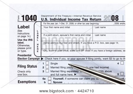 Close Up 1040 Tax Form With Pen