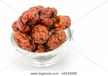 Dried Chinese Jujubes Fruits On White Background.