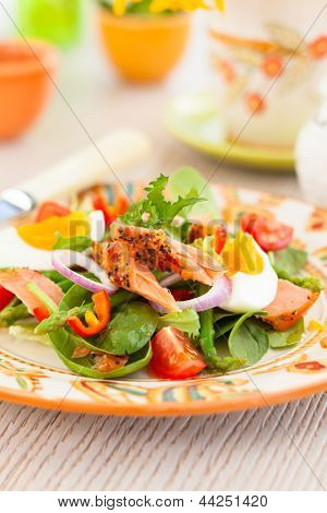 salmon salad with egg and vegetables