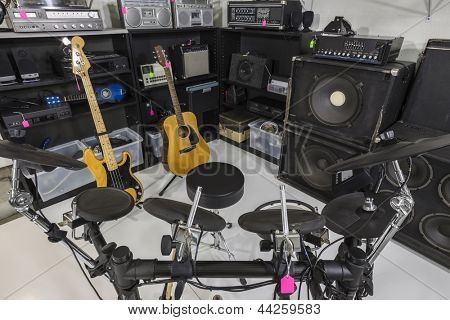 Interior music store with vintage used equipment.