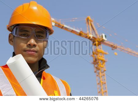 Close Up Site Manager With Safety Vest Under Construction
