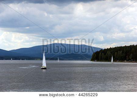 Sailing yachts on Lipno lake, Czech Republic.