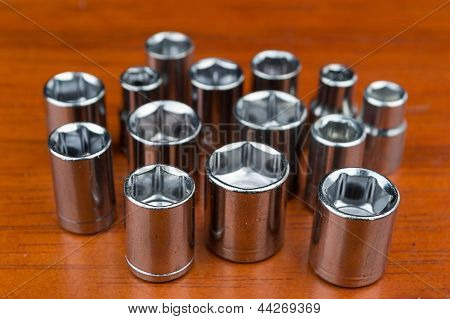 Set of chromeplated wrench dadoes, on wood