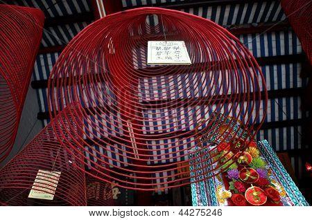 Burning hanging incense coils, Hoi An, Vietnam