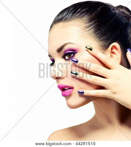 Fashion Beauty . Manicure and Make-up. Nail art. Beautiful Woman With Colorful Nails and Luxury Purple Makeup. Beautiful Girl Face and Hand