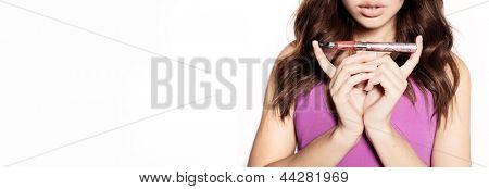 woman smoking e-cigarette wearing purple dress