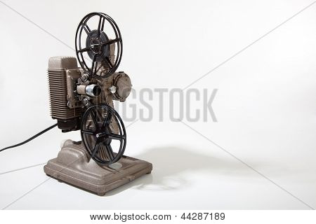 A vintage 8mm movie projector on a white background with copy space