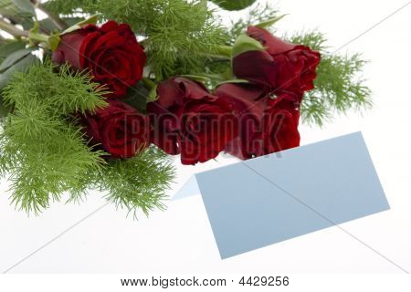 Red Roses With A Blue Place Card