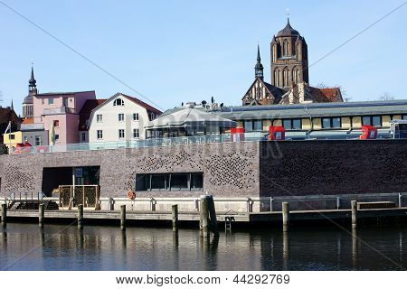 The photograph of the city of Stralsund, across a canal harbor area. poster