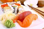 Fish sushi with wasabi and chopsticks close up poster