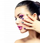 Fashion Beauty . Manicure and Make-up. Nail art. Beautiful Woman With Colorful Nails and Luxury Purple Makeup. Beautiful Girl Face and Hand poster