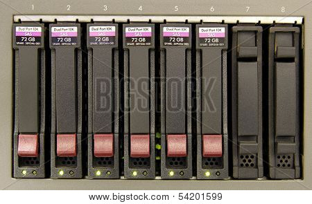 an array of six hard drives for storage close-up poster