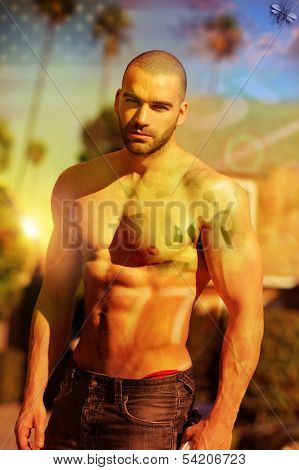 Stylized fashion portrait of a hot shirtless muscular male model with cross processing and overlay retro effects