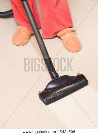 Housewife Vacuum A Carpet