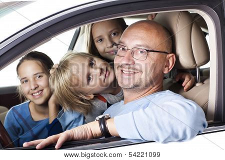 Huppy Father With Children In A Car