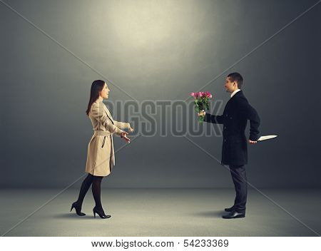 crafty man with flowers and knife waiting young woman