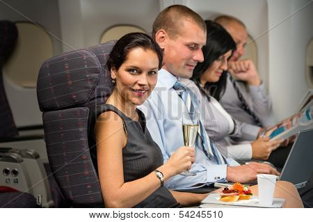 Business travel by airplane woman enjoy refreshment flight cabin passenger