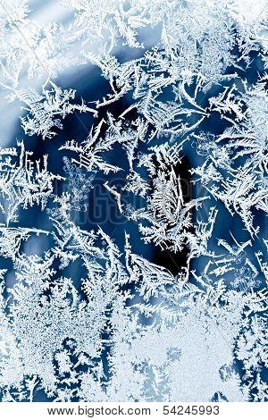 Frosty ice flower pattern on the window poster
